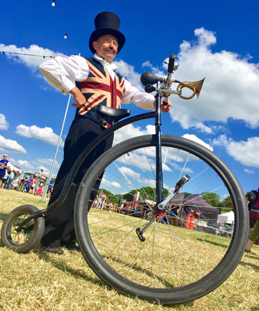 Eroica Britannia bicycle entertainer Penny Farthing rider bicycle themed entertainment