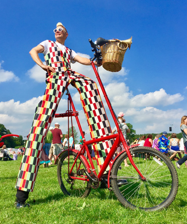 Stilt bicycle - Stilt bicycle rider - festival entertainer - bicycle themed