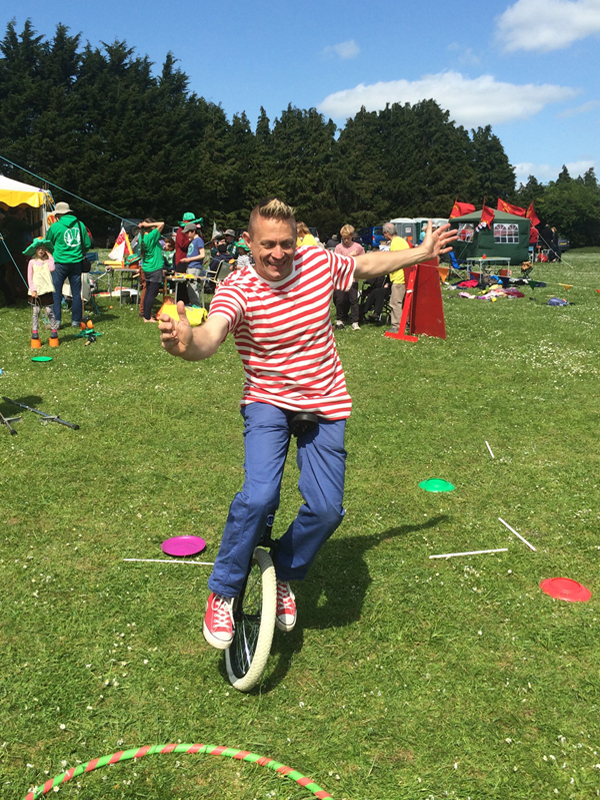 Circus skills school workshop - Thomas trilby rides a unicycle