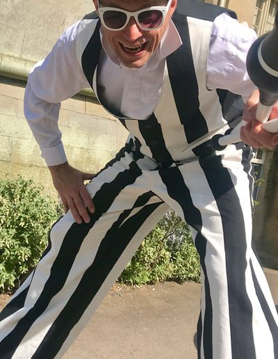 Thomas-Trilby-striped-entertainment-detailed-costumes-juggler
